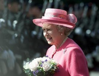 HM The Queen moves out to inspect the Honour Guard