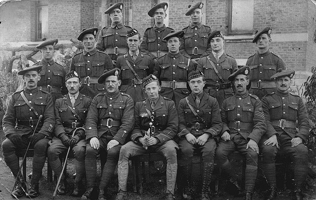 Gordon Llewellyn Griffiths (1888 - 1943) with a group of Cameron Highlanders. Middle row, centre wearing Glengarry